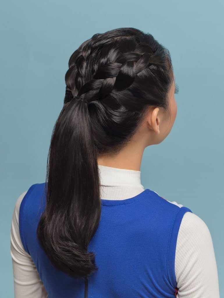 Back shot of an Asian woman with long black hair in double braided ponytail