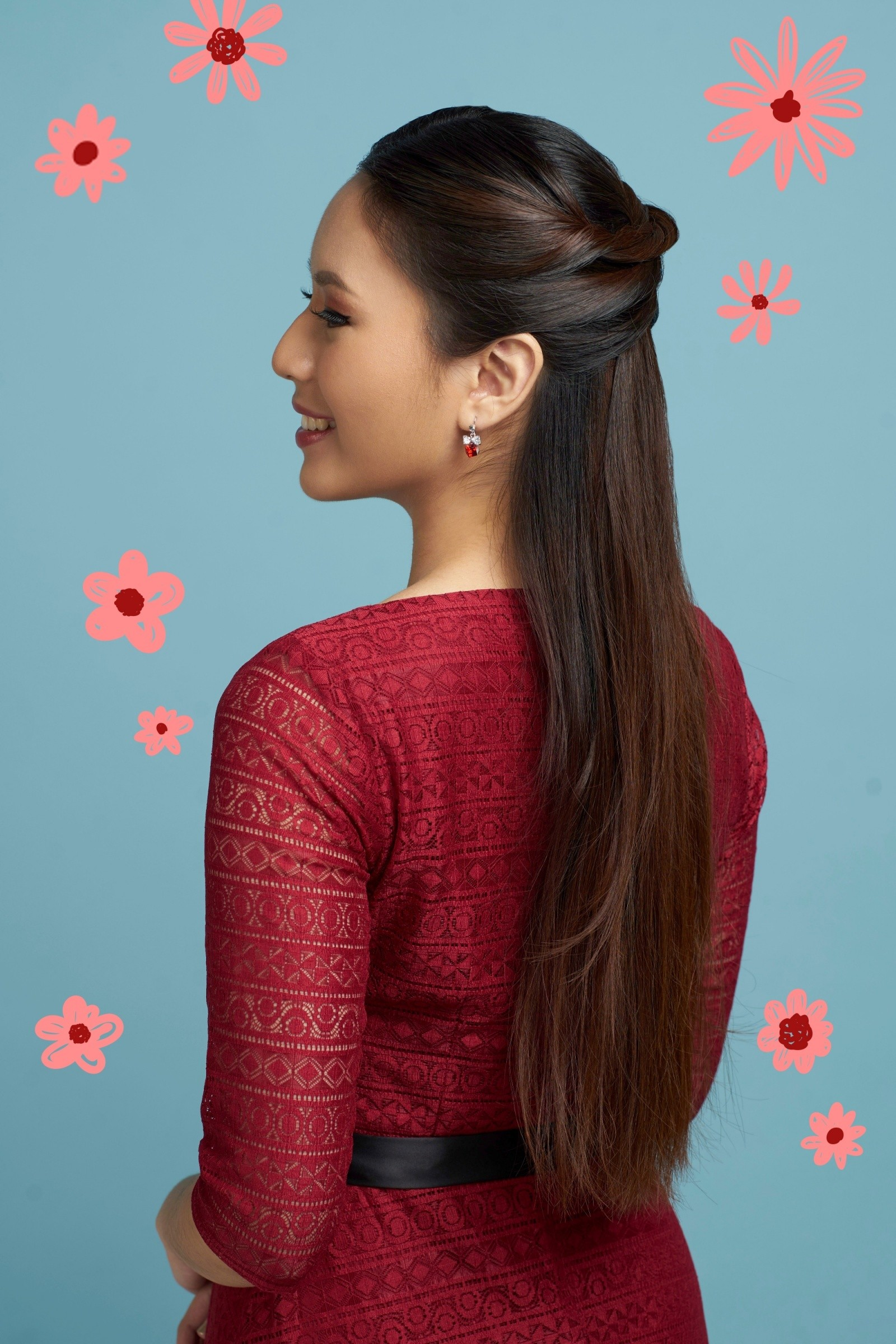 Flores de Mayo hairstyles: Asian woman with long hair in half up criss cross