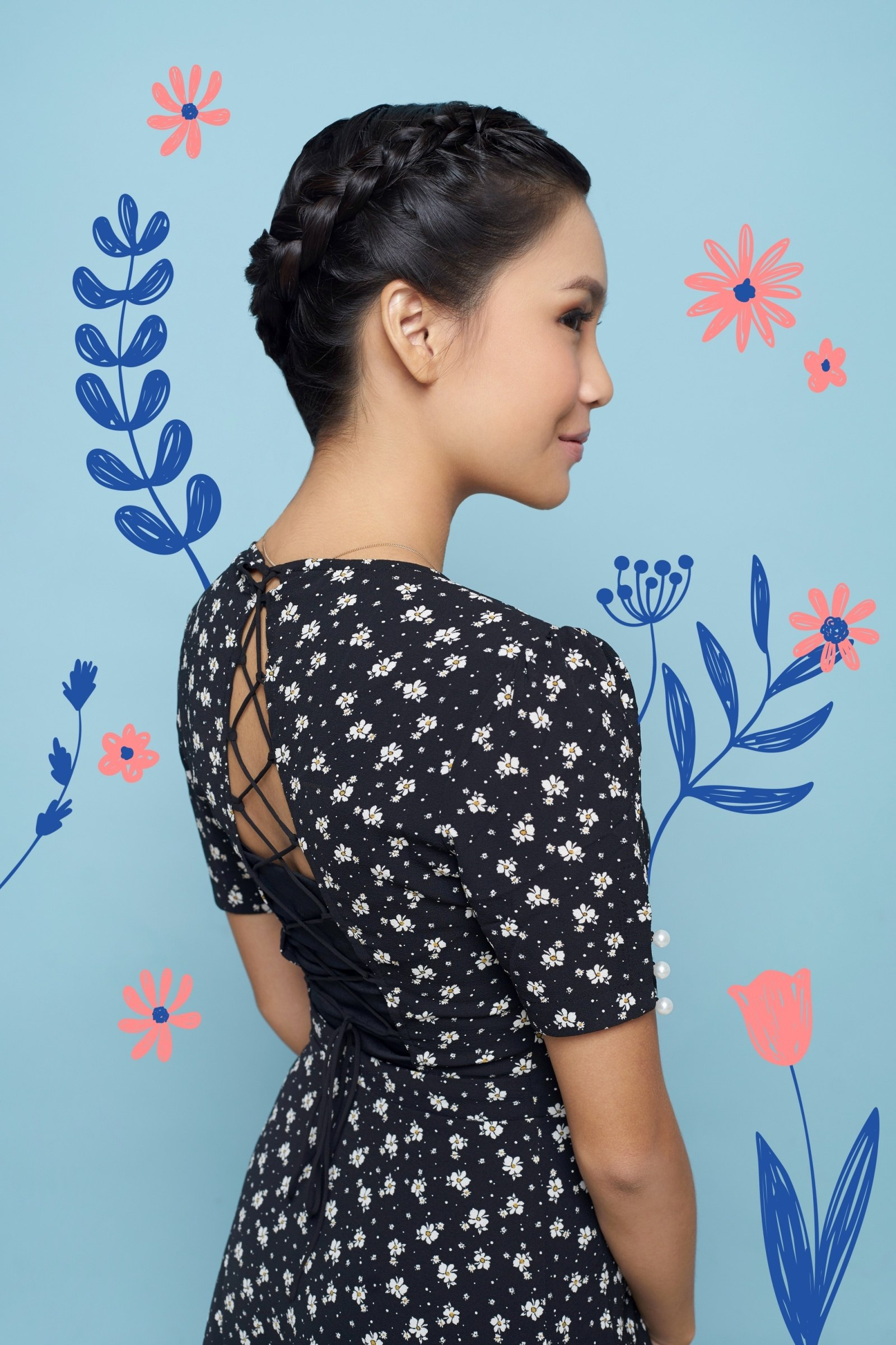 Flored De Mayo hairstyles: Side view of an Asian woman with black hair in a halo braid