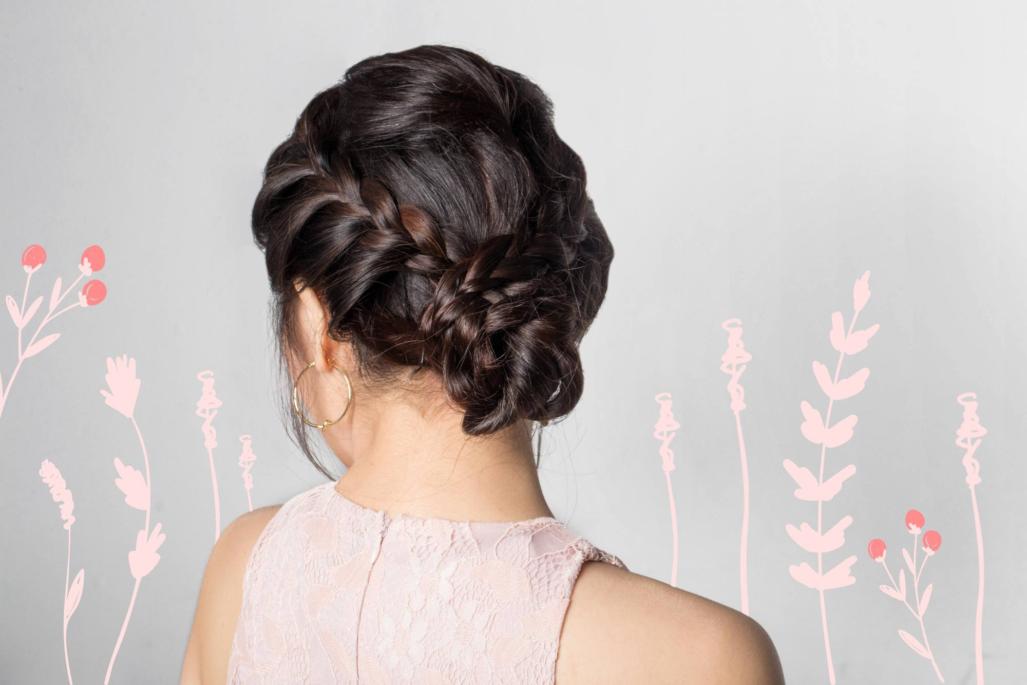 Flores de mayo hairstyles: Back shot of an Asian woman with hair in lace braid updo