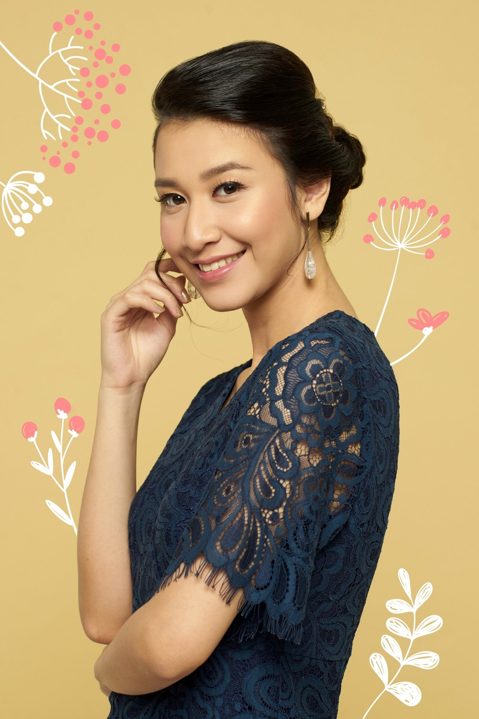 Flores de Mayo hairstyles: Asian woman smiling with long hair in a lazy bun