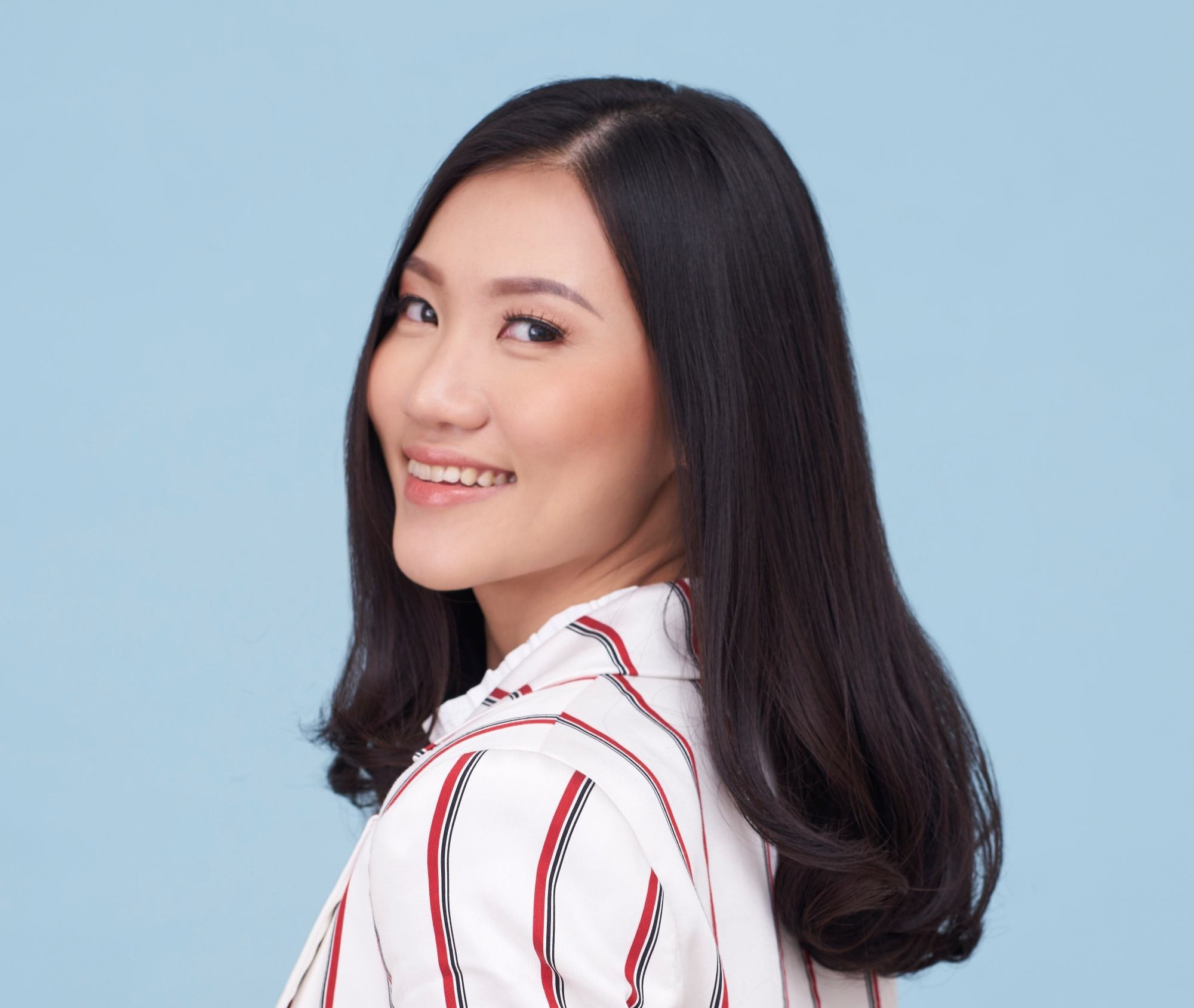 Hair facts: Asian woman with medium-length black looking at the camera