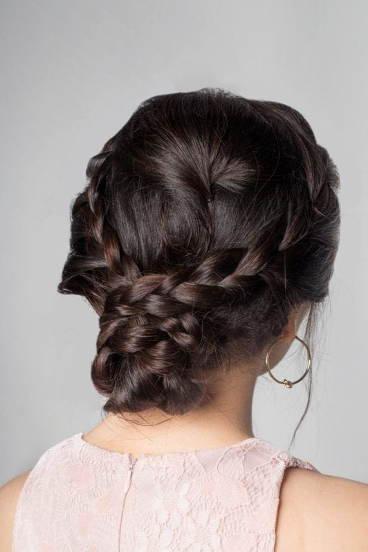 Lace braid updo: Closeup shot of an Asian woman's dark hair in lace braid updo