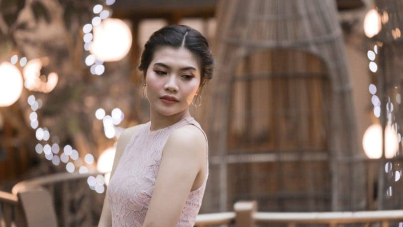 Lace braid updo: Asian woman dressed up for a party in a party venue