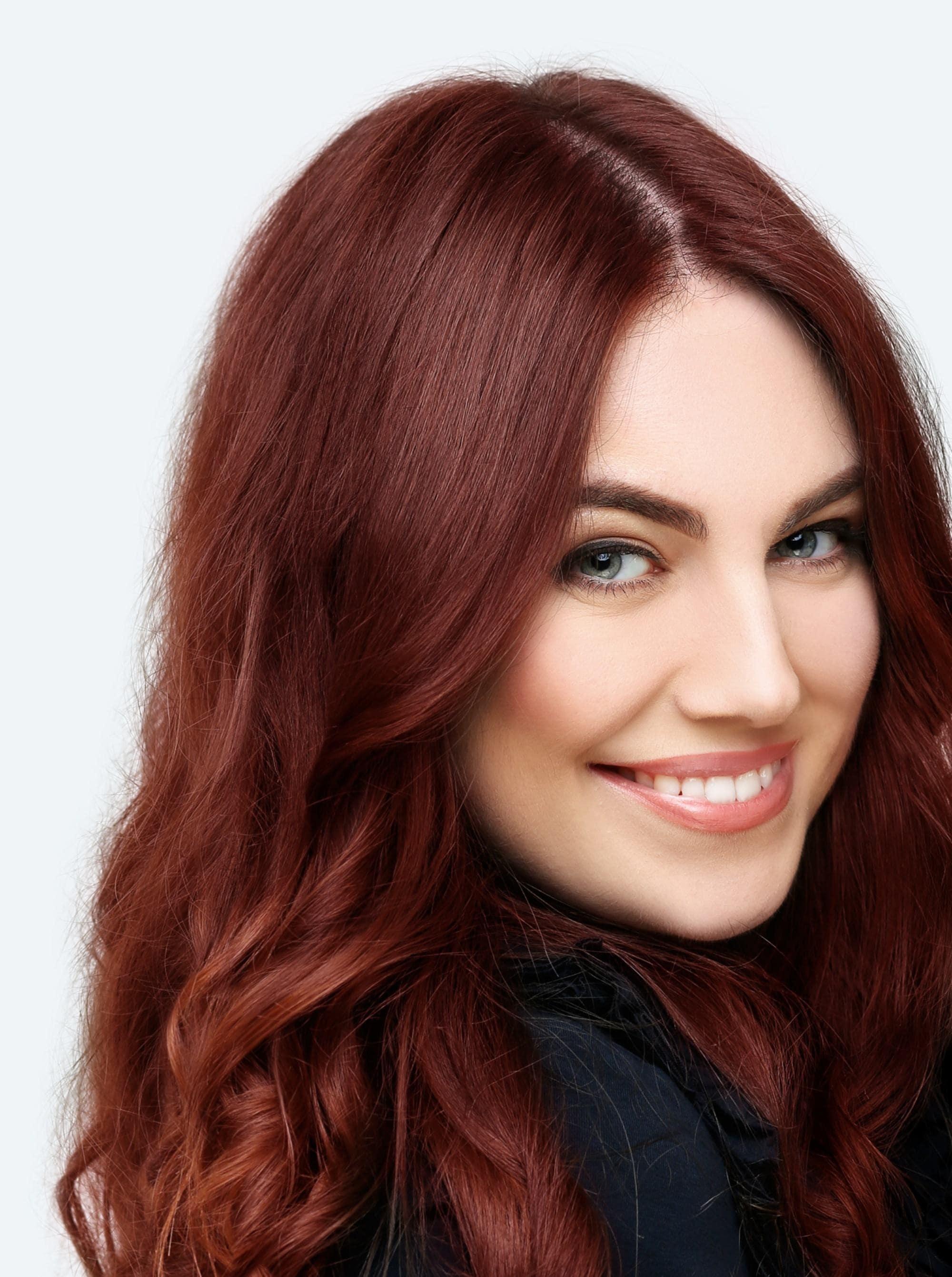 Mahogany Hair Color: Closeup shot of a woman with long mahogany hair