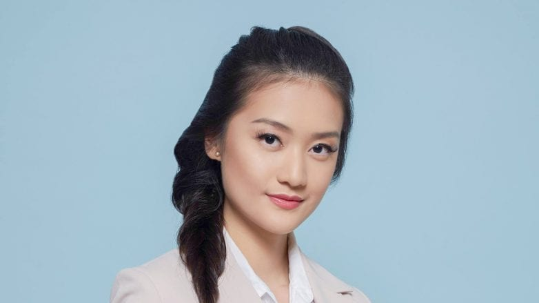 Rectangle Face: Asian woman with long hair in a braid wearing an office attire