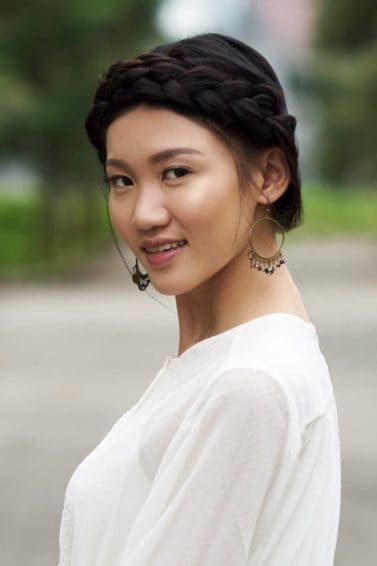 Sansa Stark: Asian woman with crown braid for long hair smilling