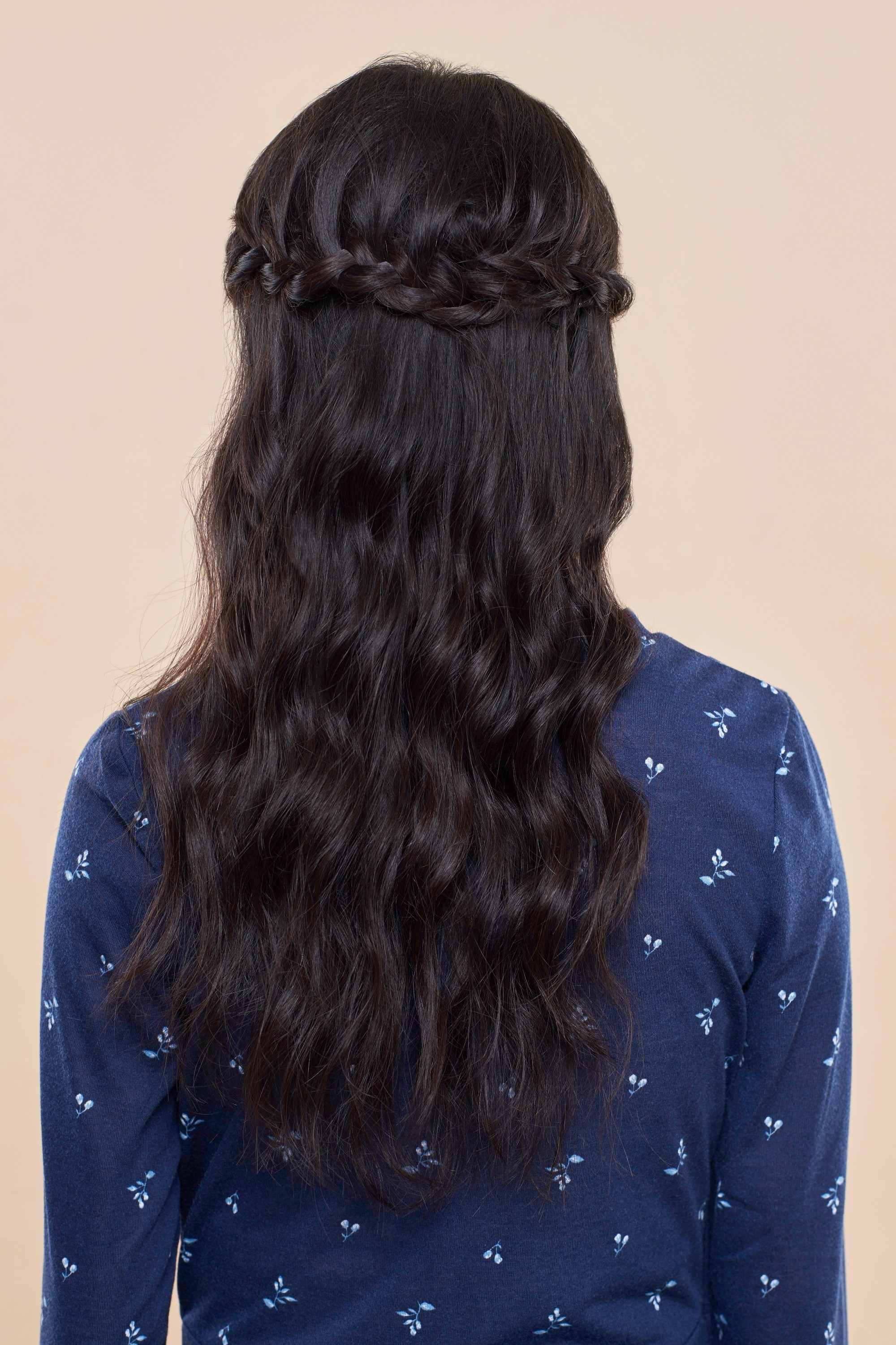 Sansa Stark Braid: Back shot of an Asian woman with long black hair in half crown braid