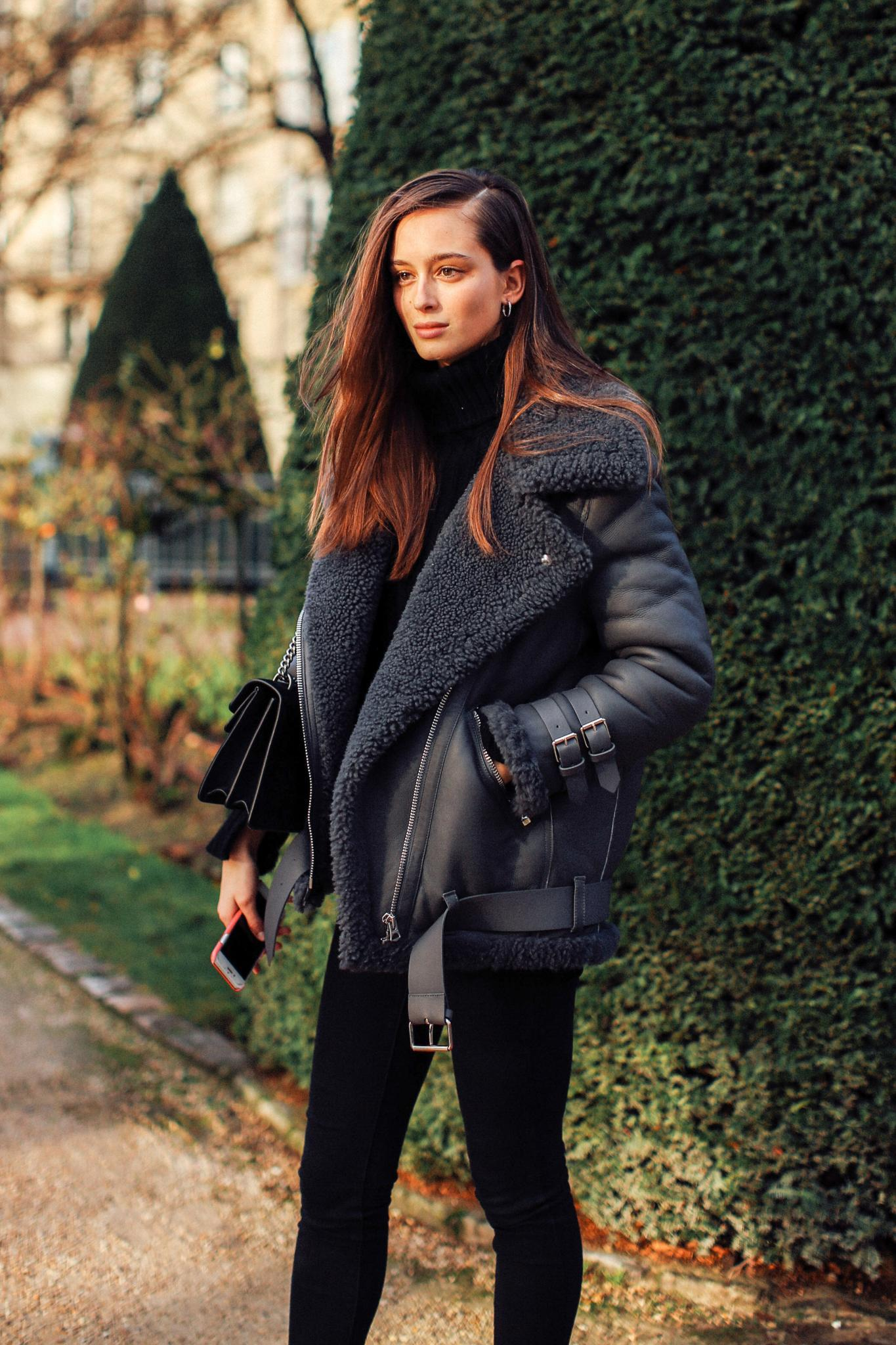 Mother's Day hair: Woman with long brown hair wearing a black coat outdoors