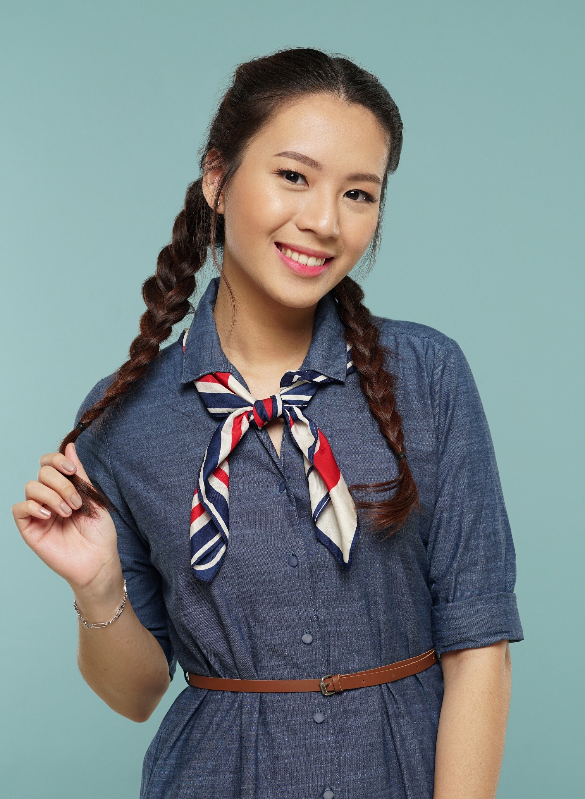 Summer Sale: Asian woman with long dark hair in messy two braids hairstyle smiling
