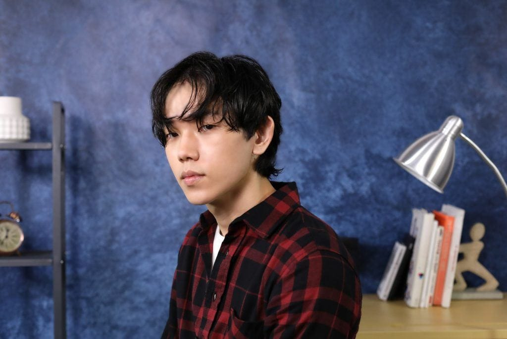 Asian guy is sporting his wet hair and ready for his Korean wavy hairstyle for men