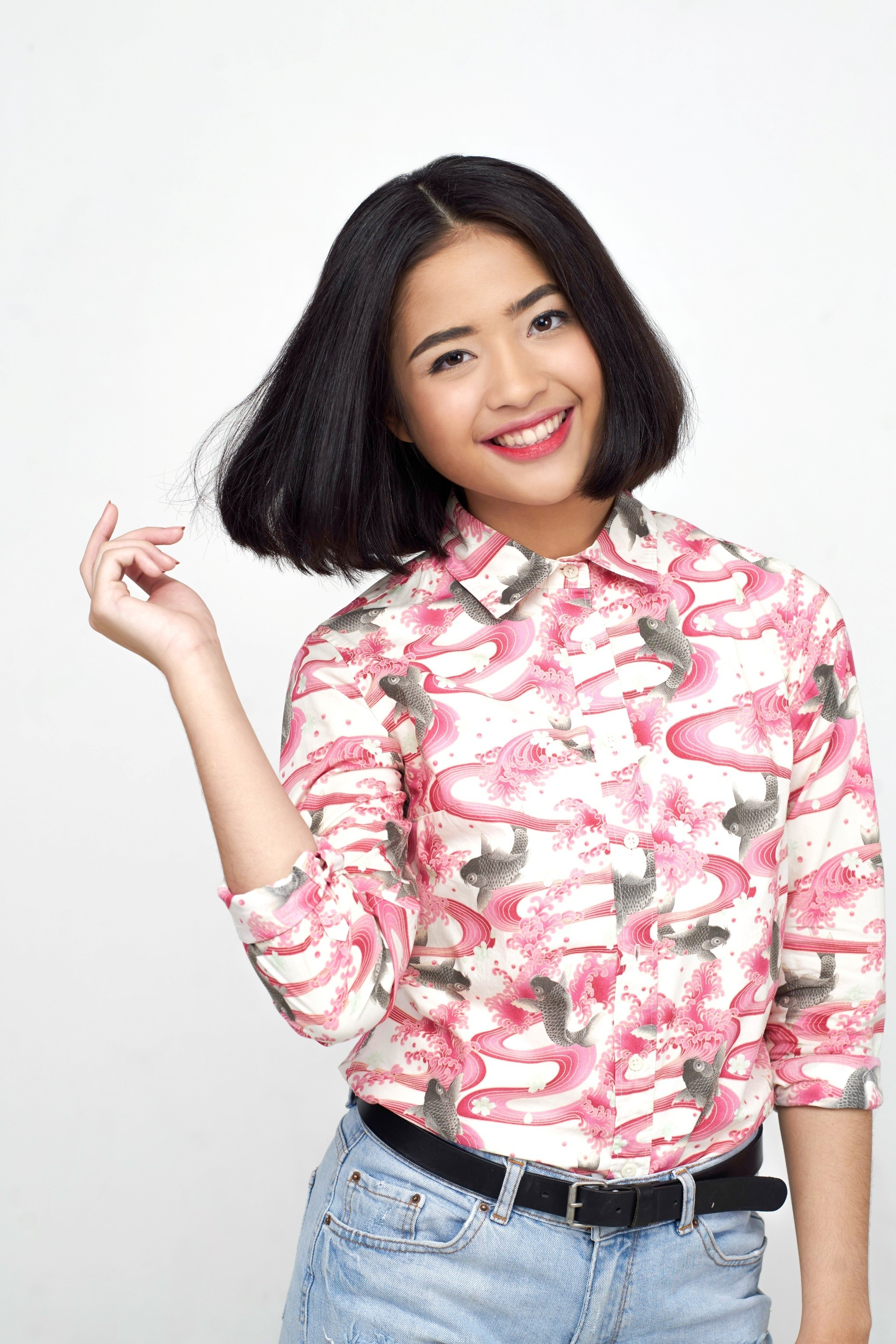 Asian woman with a center-parted bob hairstyle
