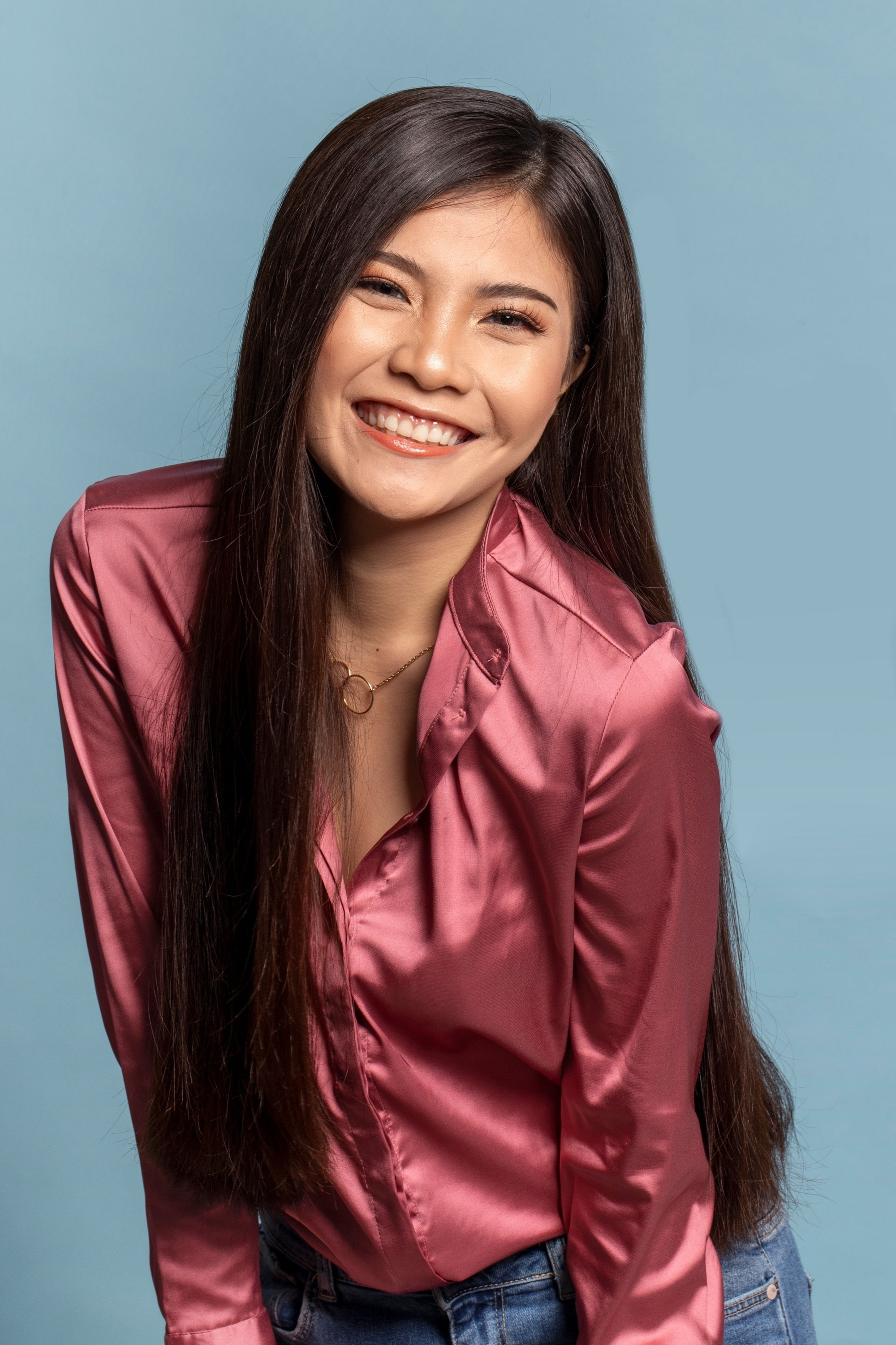 Cellophane hair Asian woman with long dark hair smiling