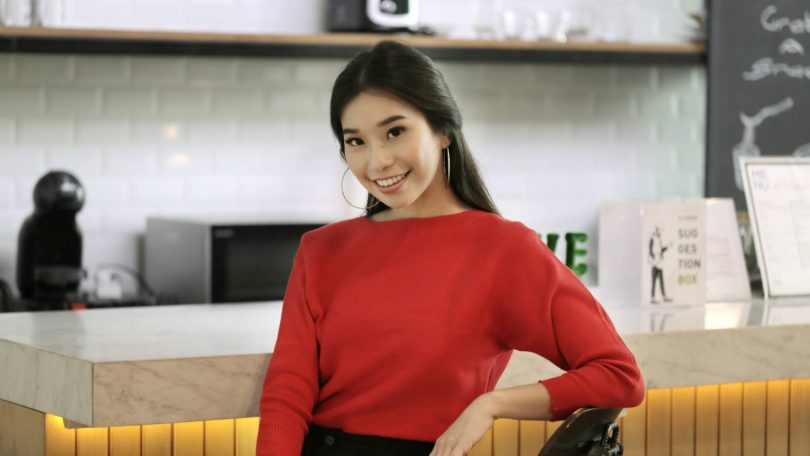 Asian woman with Celtic knot half updo on her long dark hair