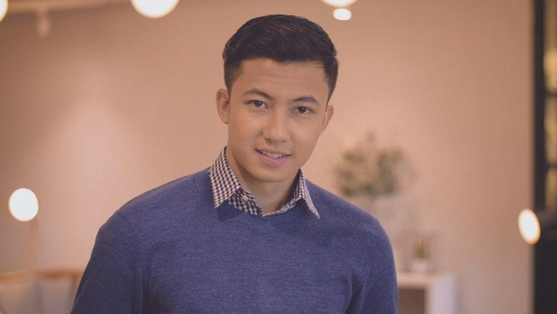 Asian man with comb over hairstyle