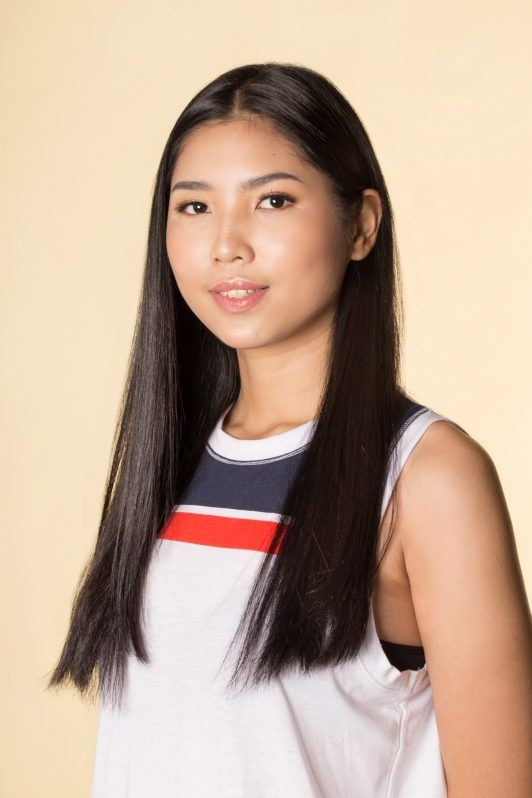 Asian woman with long straight black hair wearing a sleeveless top