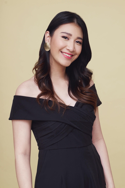 Graduation hairstyles: Asian woman with long dark wavy hair smiling