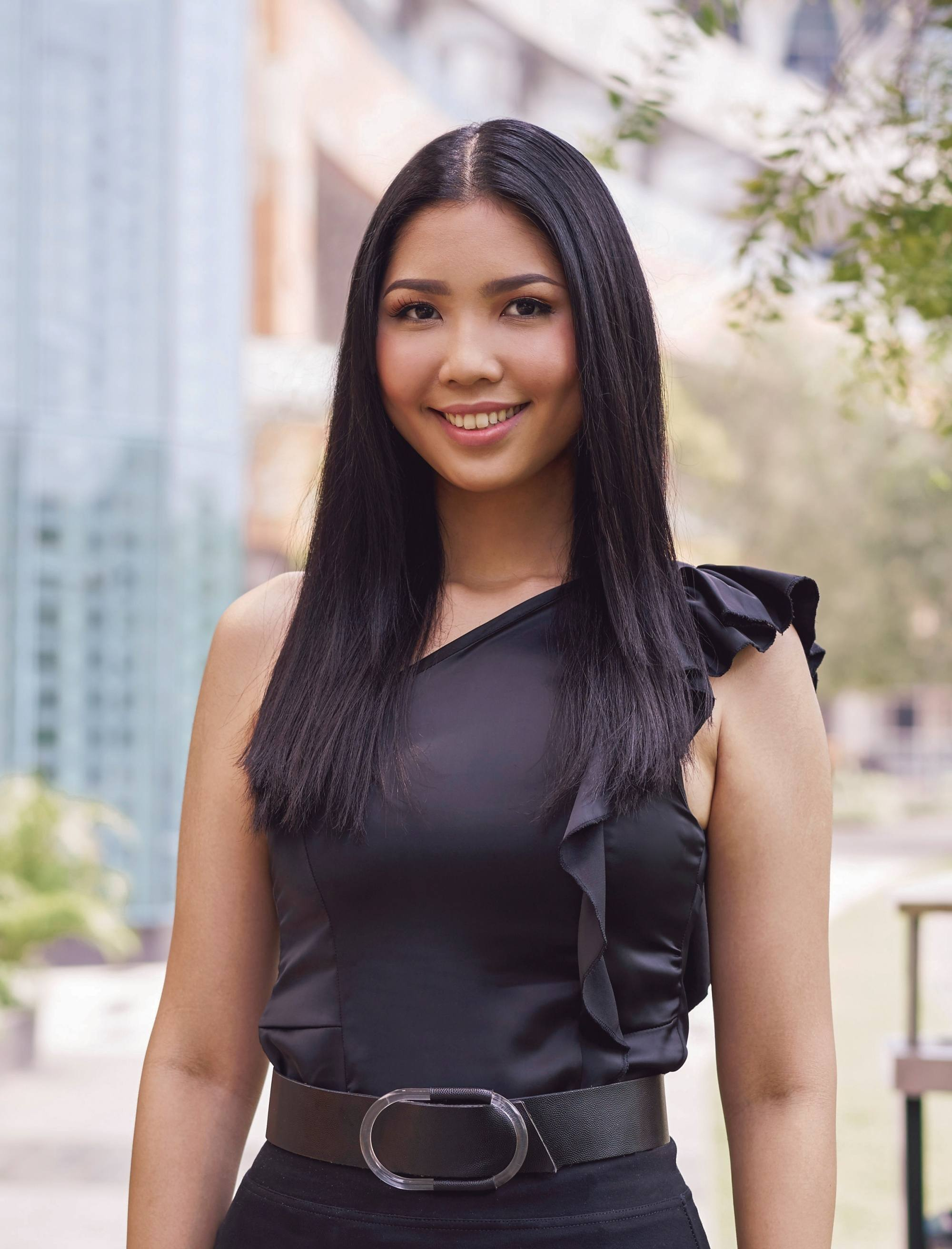 Graduation hairstyles: Asian woman with long dark straight hair smiling