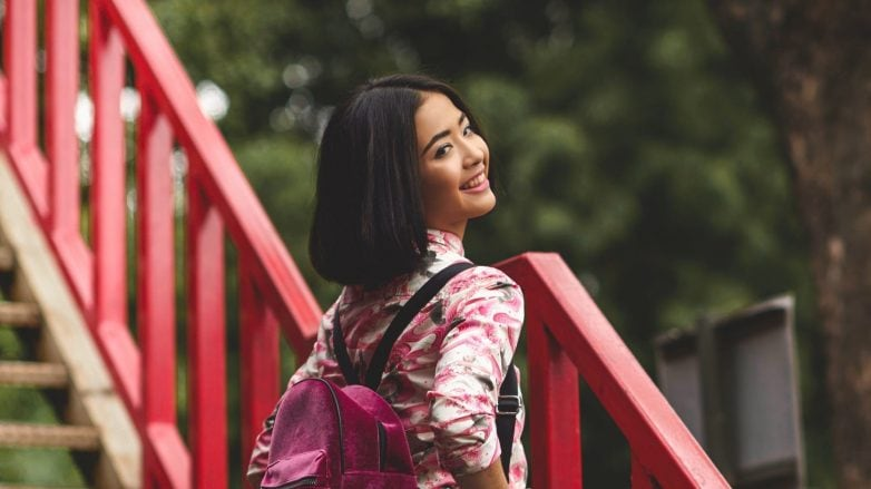 Hair care tips for commuters: Asian woman with short hair outdoors