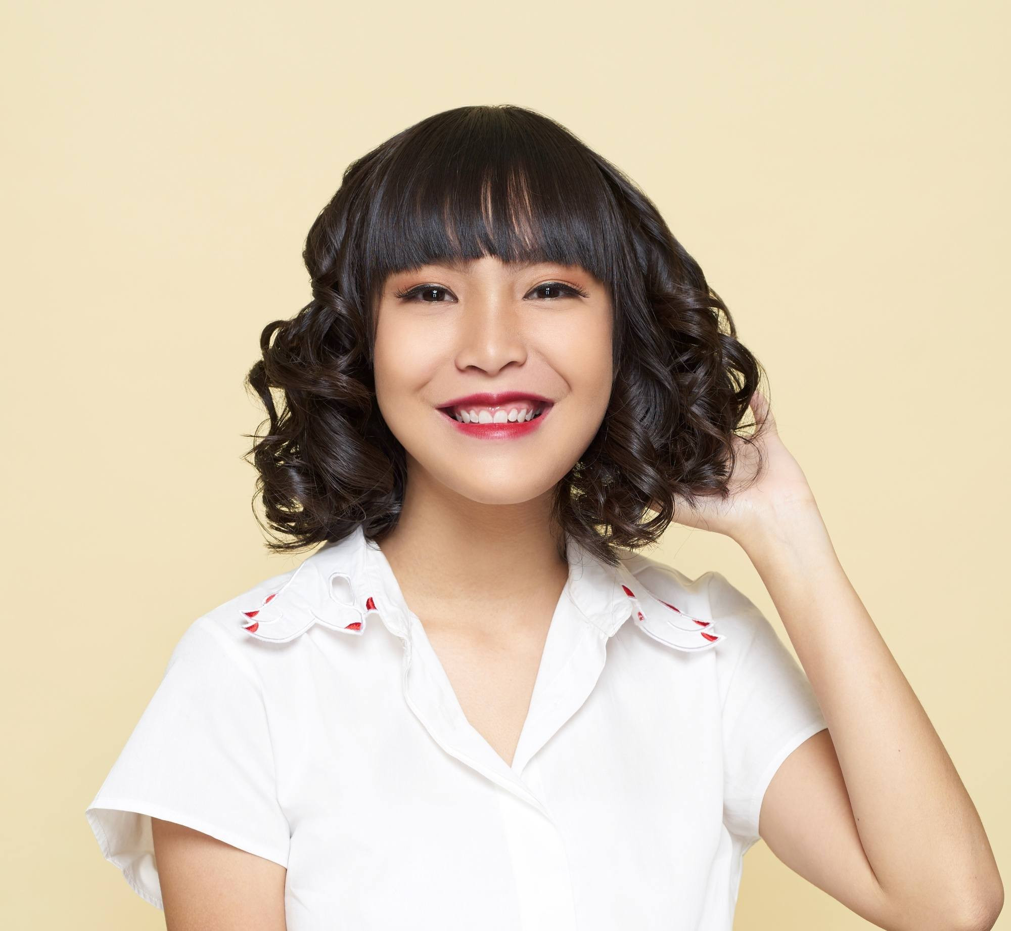 Short Curly Hair With Bangs And Layers 73