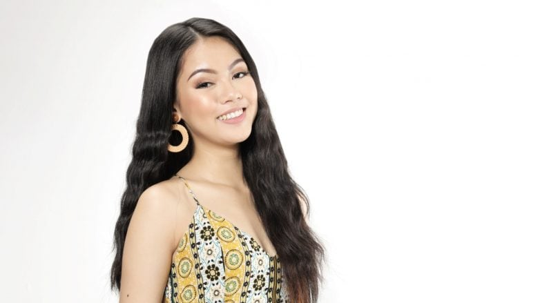 Asian woman with long mermaid waves smiling