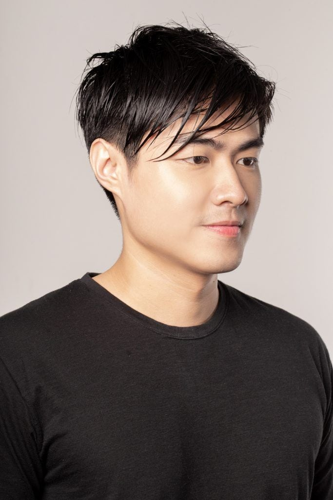 Modern quiff for men: Asian man with damp hair