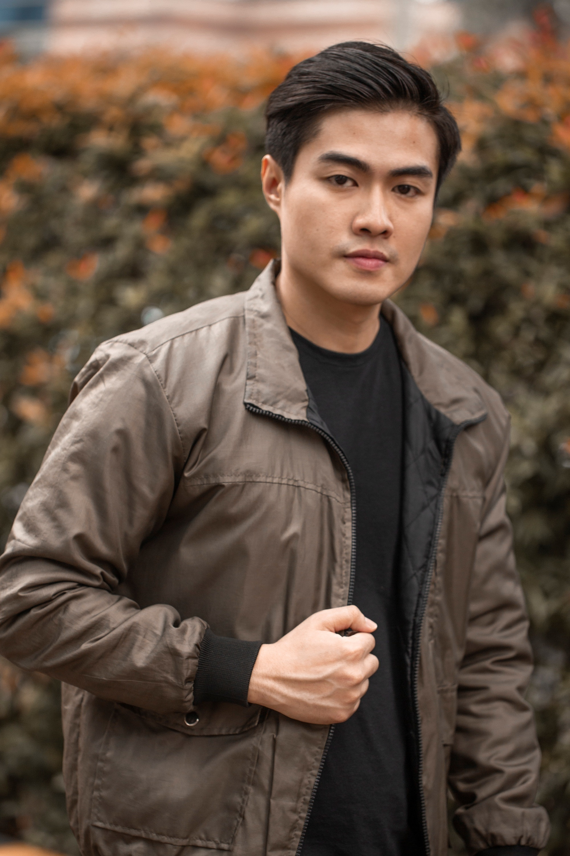 Asian man with modern quiff for men wearing a jacket