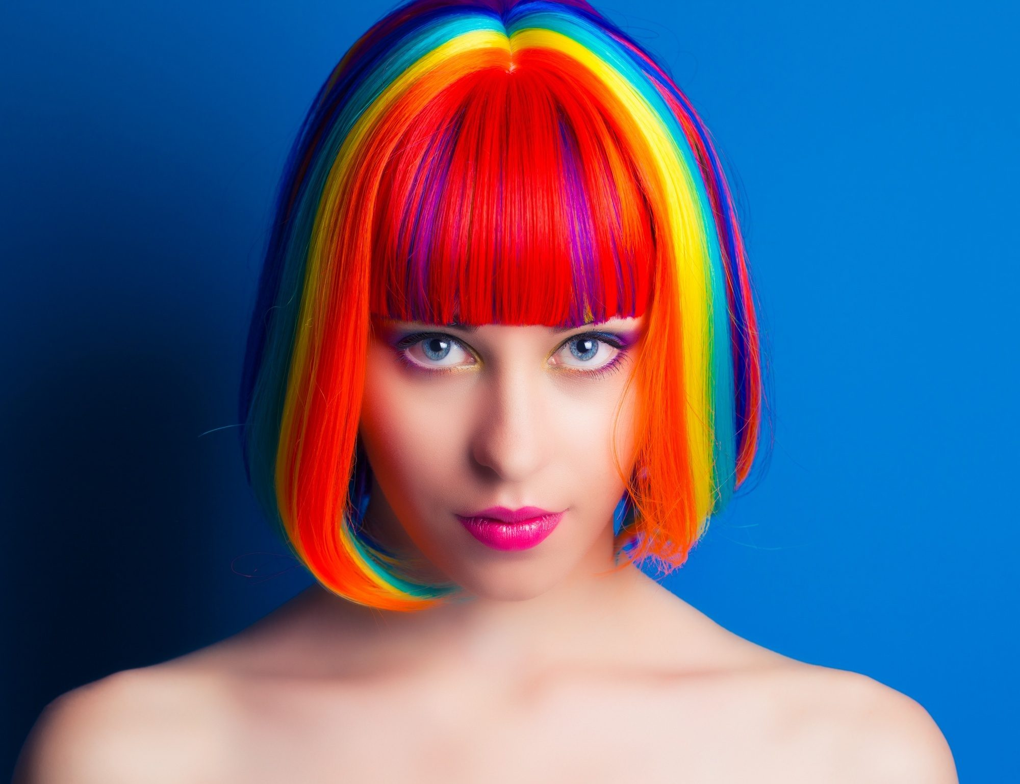 Woman with short hair with bangs with rainbow hair