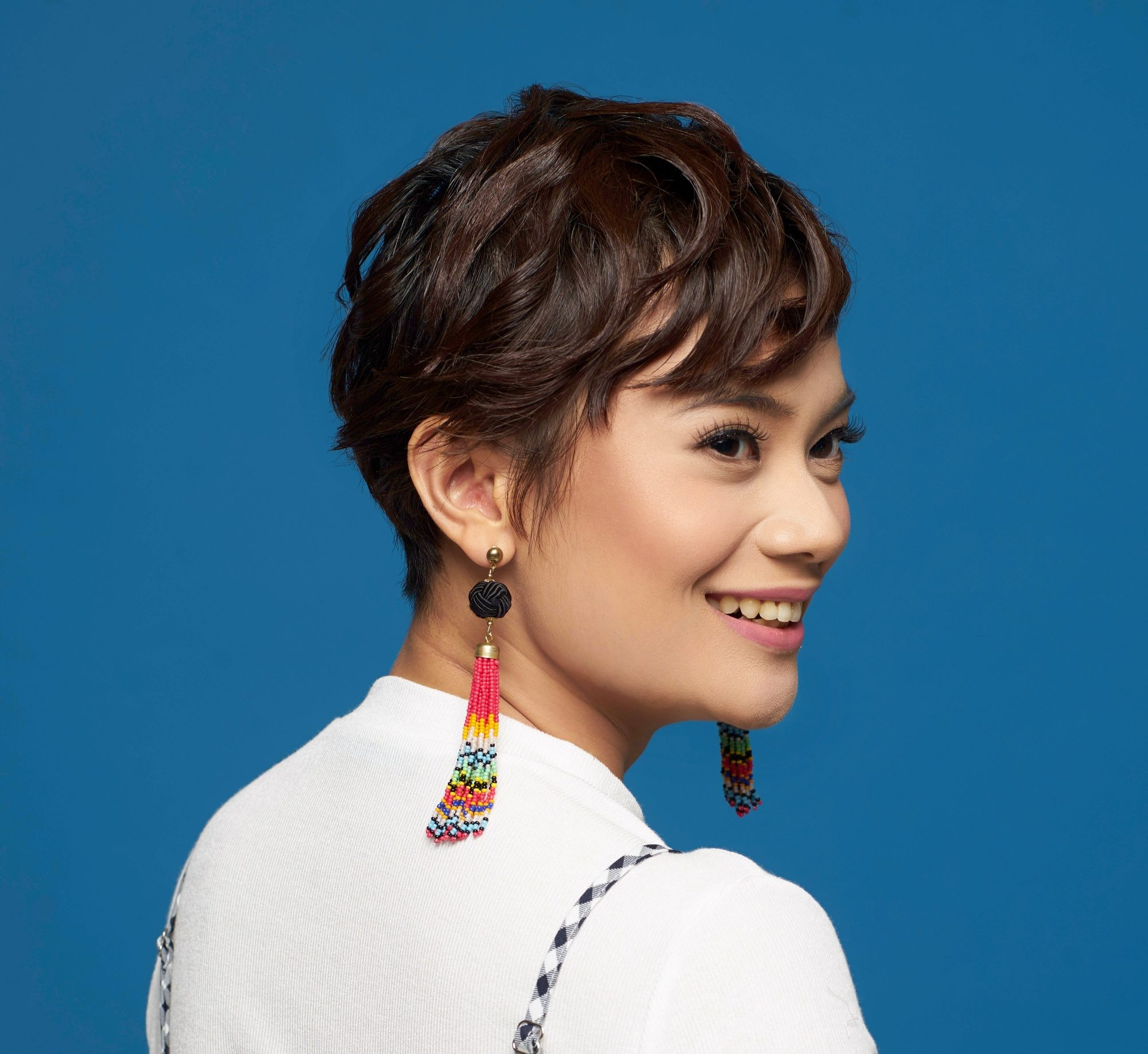 Should I get a pixie cut asian woman with pixie cut smiling