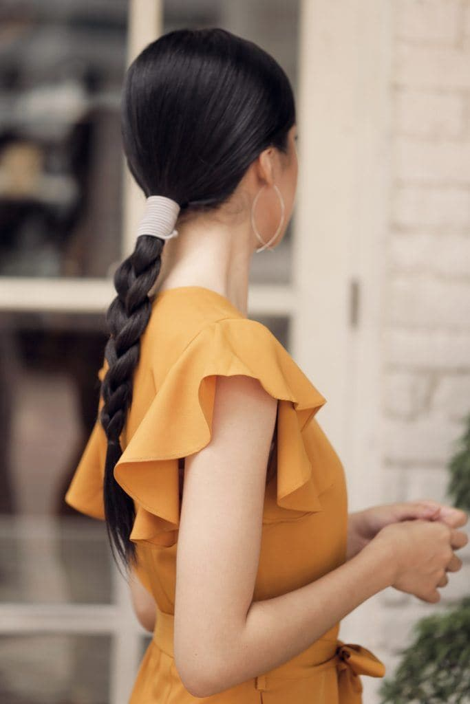 Asian woman with sleek braid with accessories