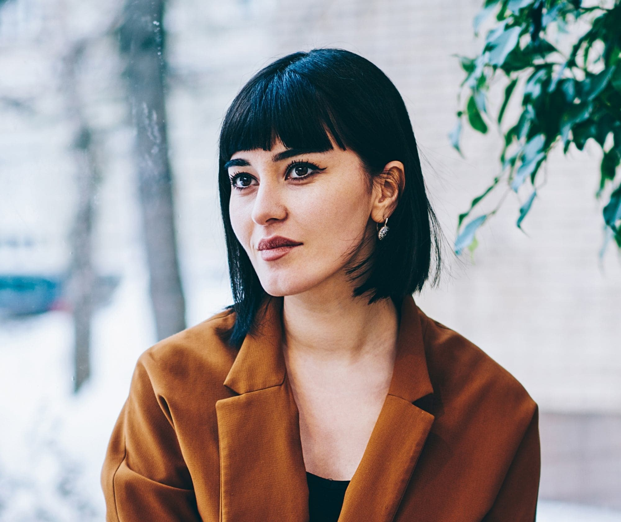 Woman with black square haircut with bangs