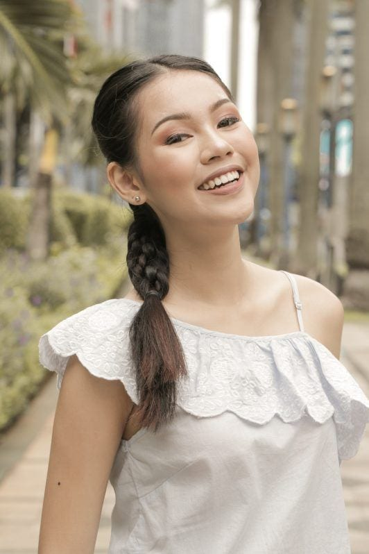 Asian woman with triple braid