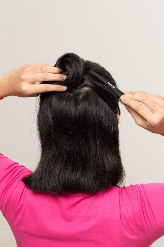 Wet look for short hair: Asian woman clipping her short hair