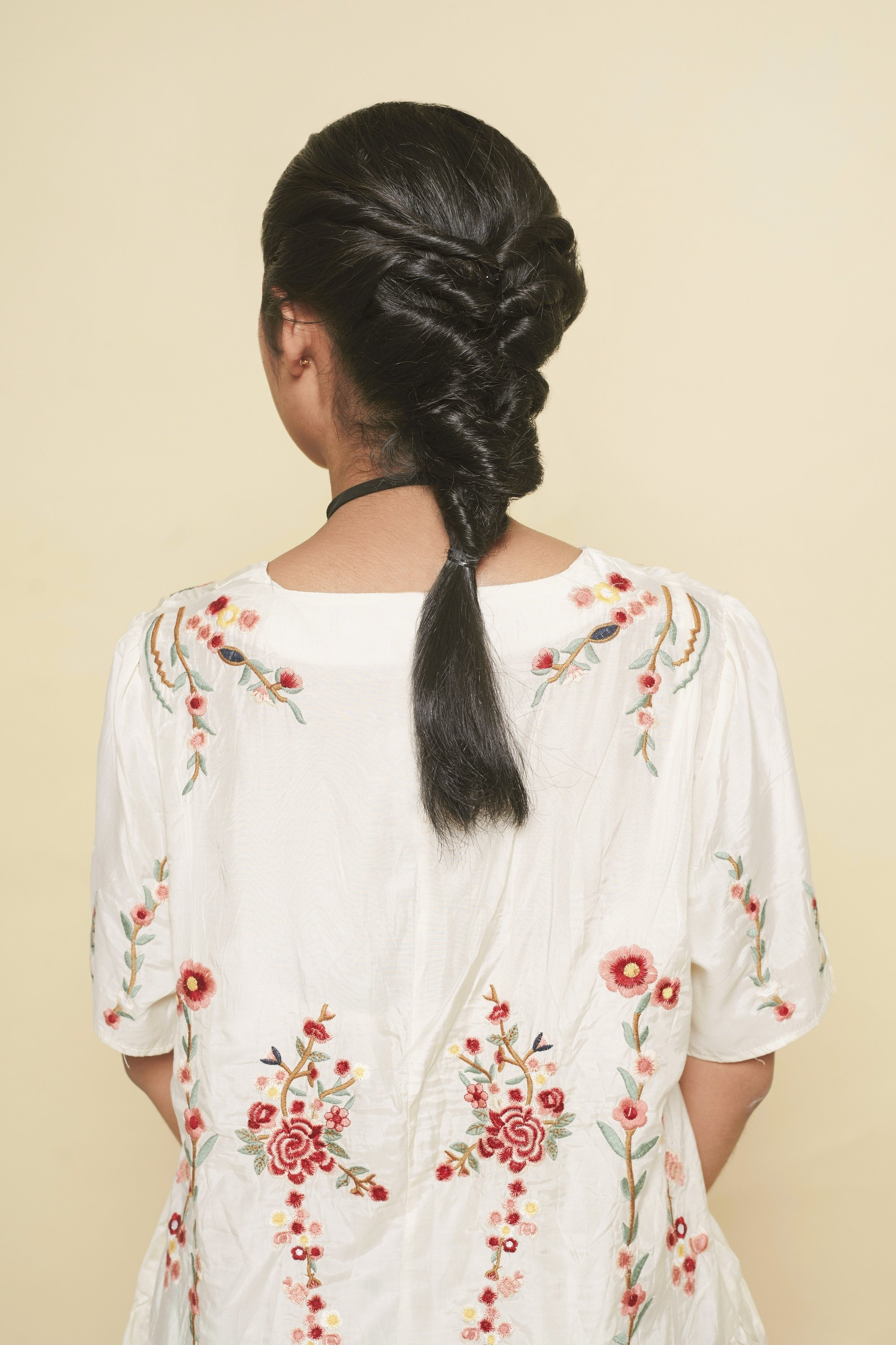 Back shot of an Asian woman with braid hair design for long hair