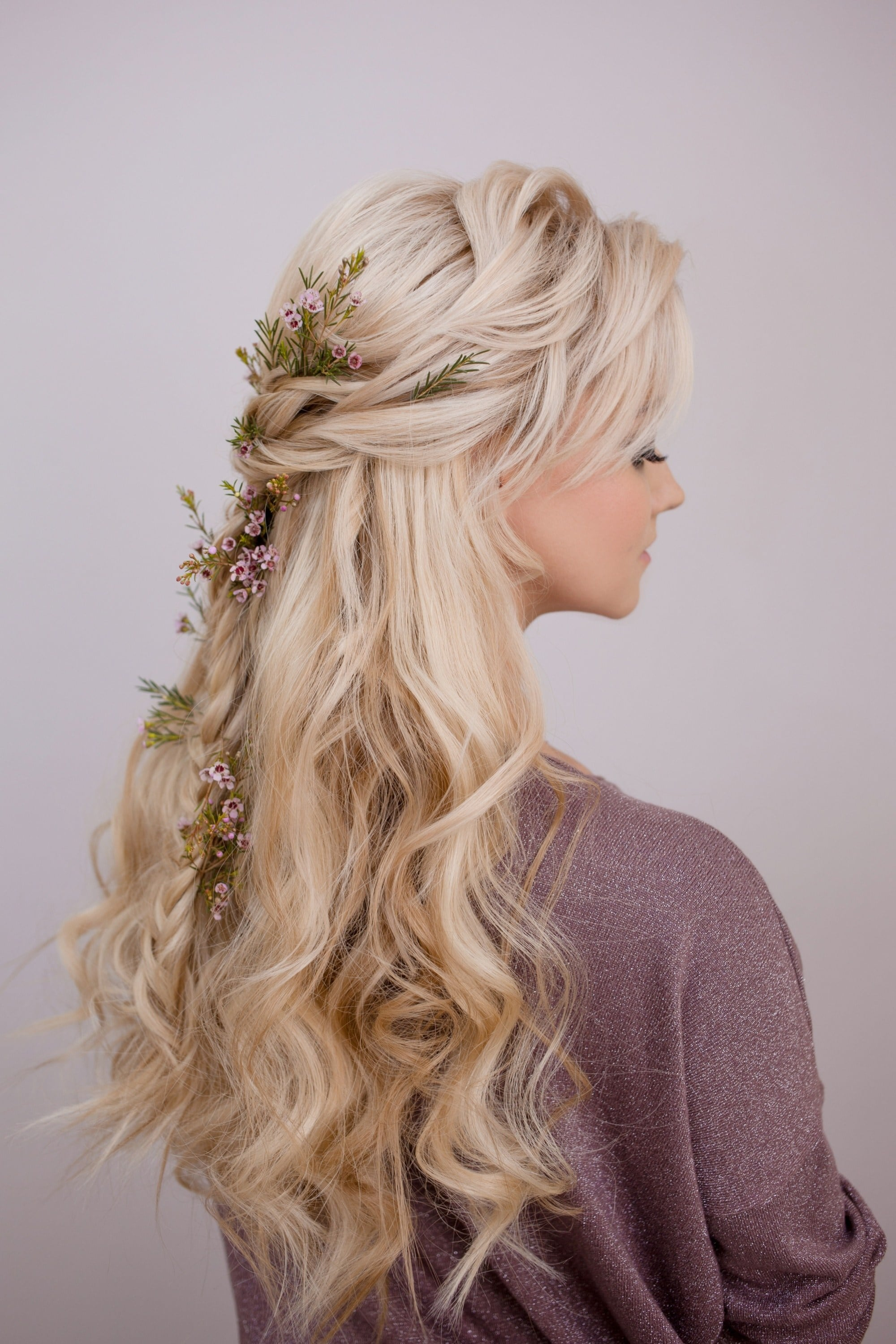 Woman with long blonde hair with flower hair design