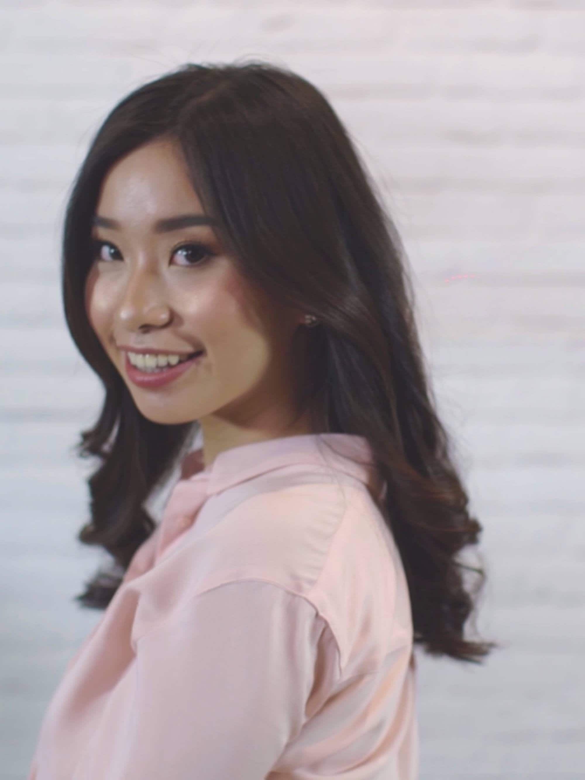How to blow out hair: Asian woman with half curls blowout