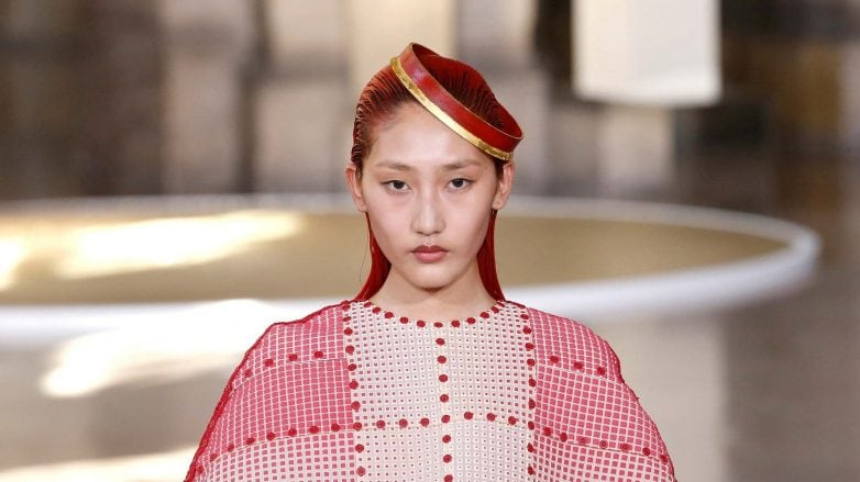 Paris fashion week haute couture model with red hair wearing a red dress
