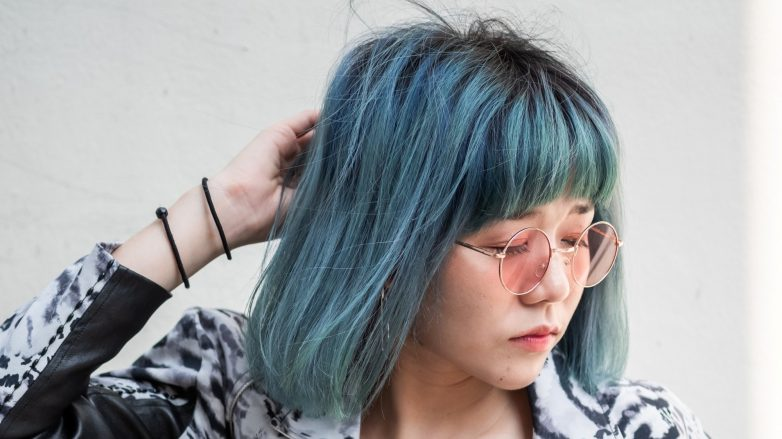 Shampoo for colored hair: Thai woman with blue lob with bangs posing