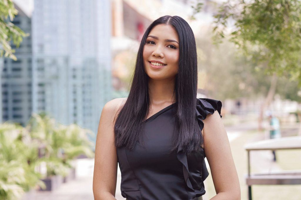 Straight hair ideas: Asian woman with long black straight hair smiling outdoors