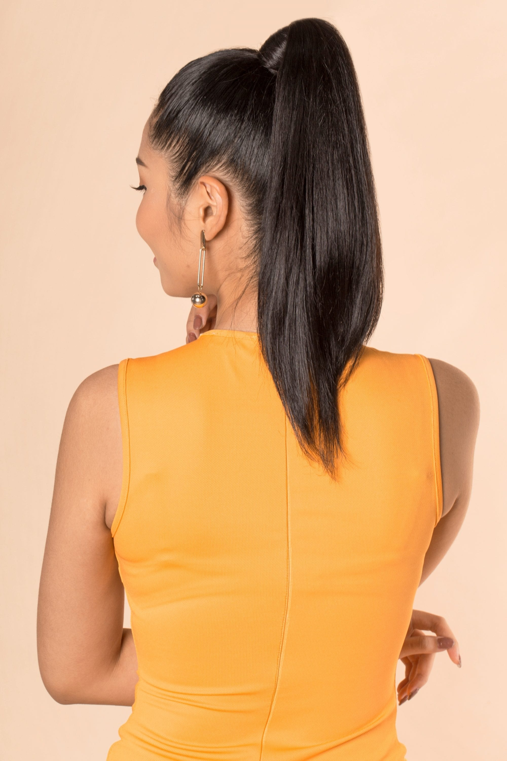 Asian woman with long black hair in a high ponytail