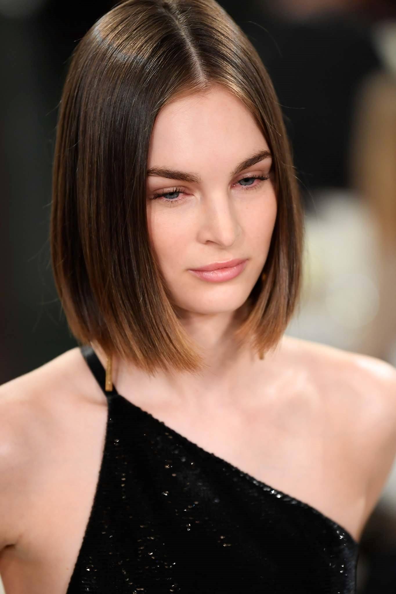 Straight hair ideas: Caucasian woman with dark medium-length hair