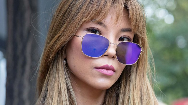 Asian woman with ash blonde hair wearing sunglasses