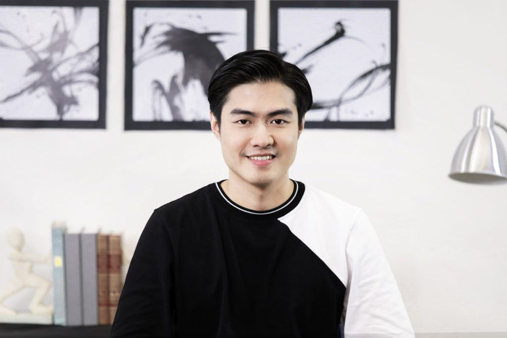 How to style men's hair without heat: Asian man with short hair wearing a sweater