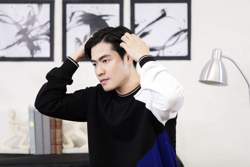 Asian man parting his hair