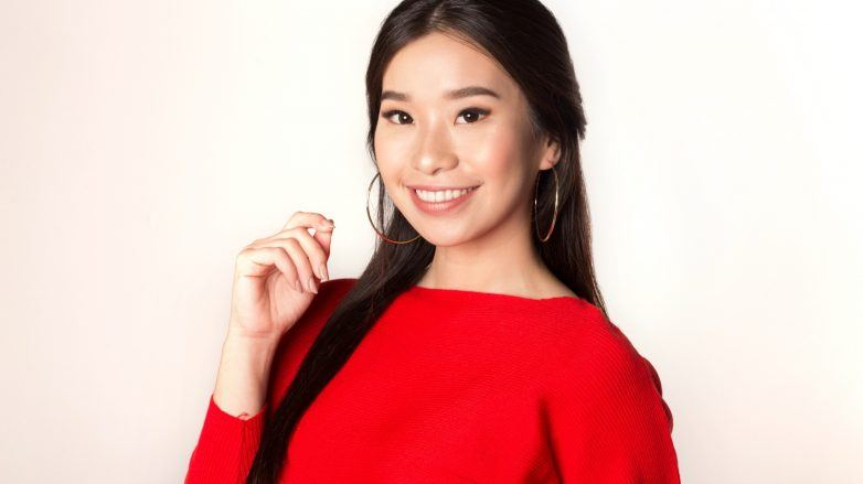 #BeautyThatCares: Asian woman with long dark hair wearing a red top