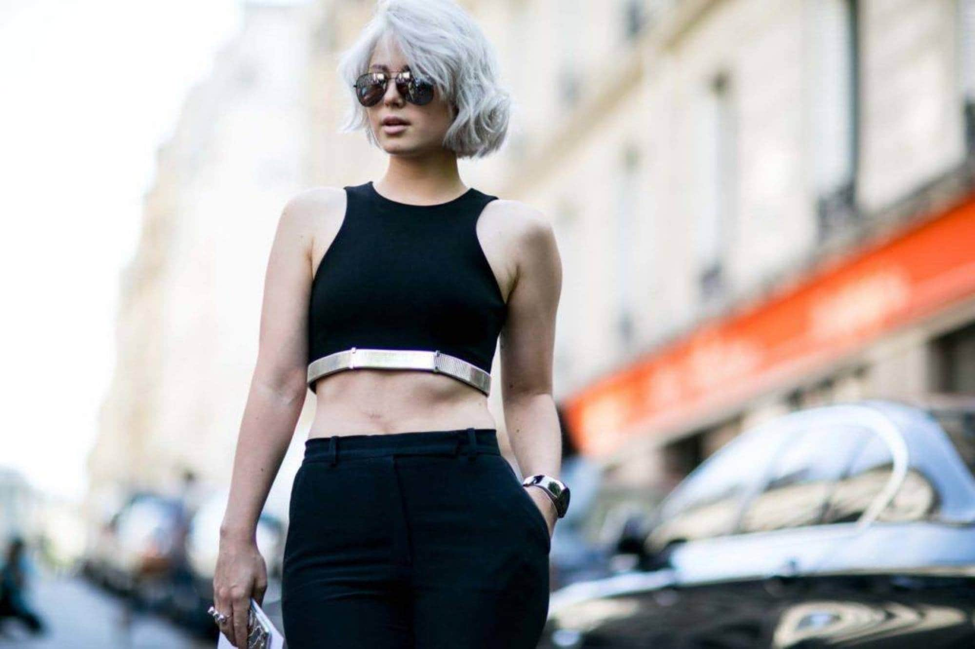 Bleached hair colors: woman with icy silver short bob wearing black