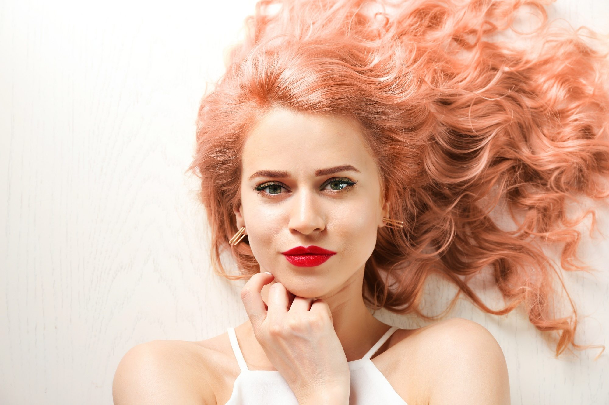 Bleached hair colors: woman with her strawberry blonde laid down
