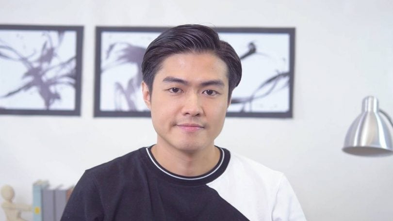 Asian model wearing a sweater for how to style men's hair without heat tutorial