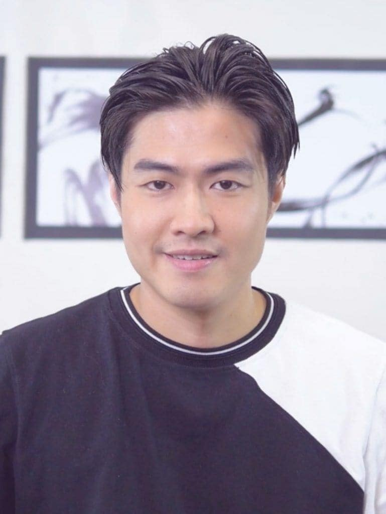 How to style men's hair without heat: Asian man smiling with his half damp hair