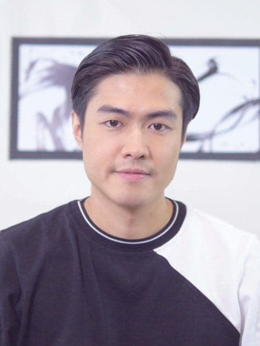 How to style men's hair without heat: Asian man smiling with this side part hairstyle